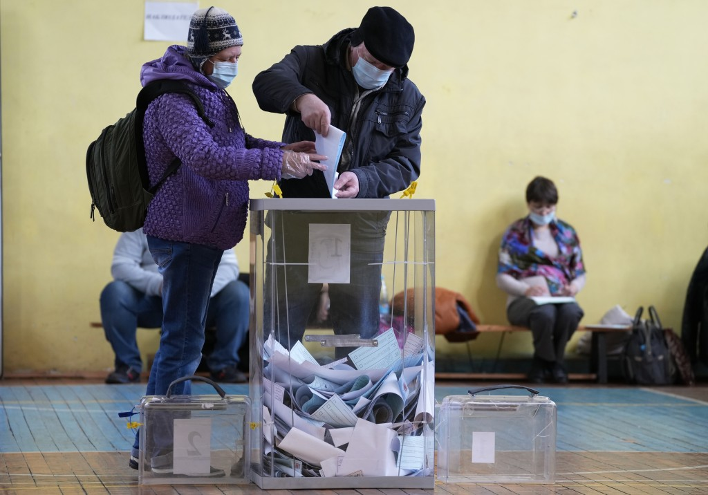 People cast their ballots during the State Duma, the Lower House of the Russian Parliament and local parliaments elections at a polling station in St....