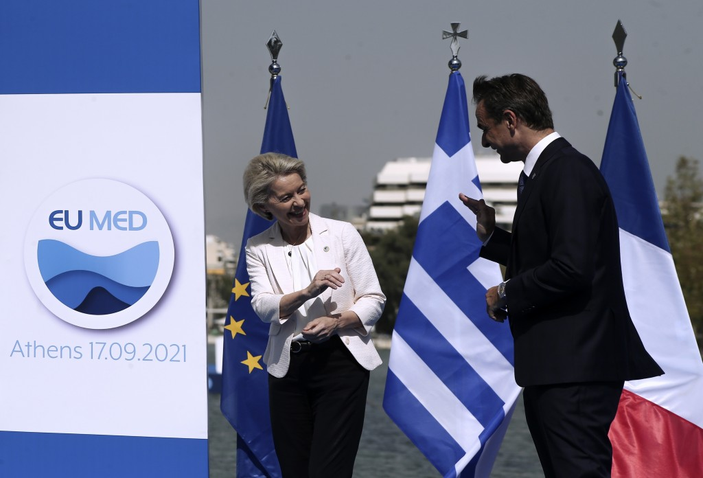 Greek Prime Minister Kyriakos Mitsotakis, right, welcomes the European Commission President Ursula von der Leyen during the EUMED 9 summit at the Stav...