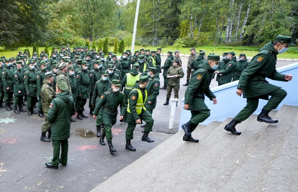 Russian Army soldiers enter a polling station to vote during the State Duma, the Lower House of the Russian Parliament and local parliaments elections...