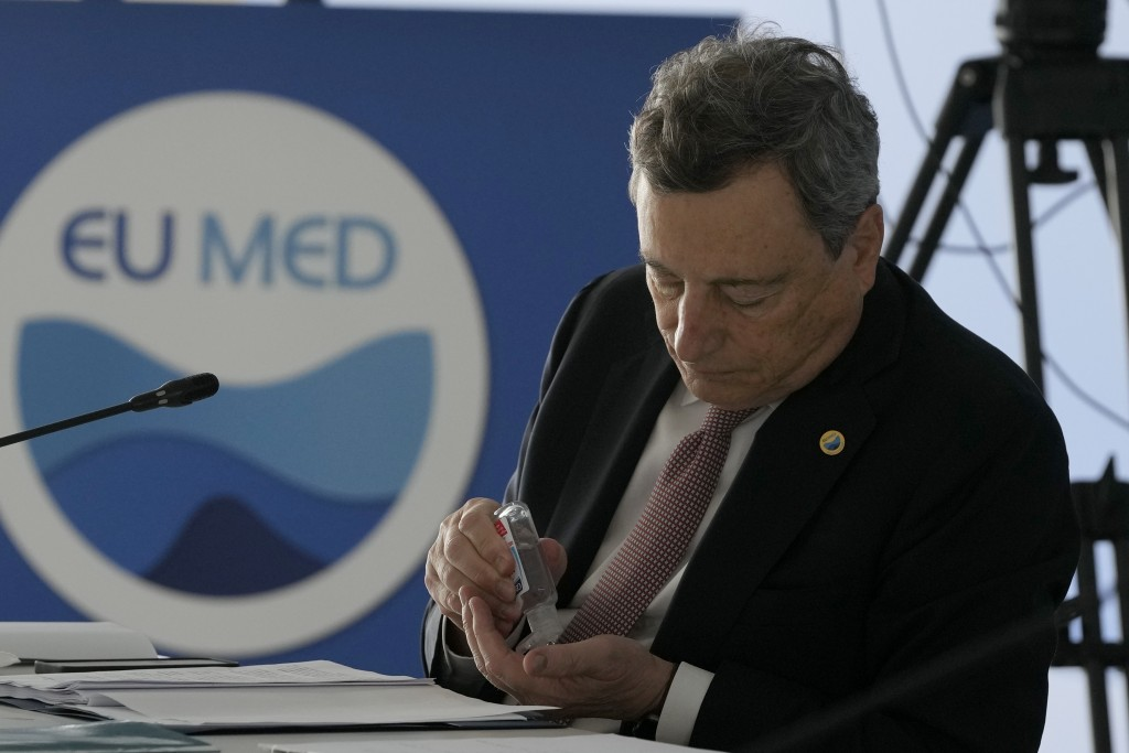 Italian Prime Minister Mario Draghi attends the EUMED 9 summit at the Stavros Niarchos Foundation Cultural Center in Athens, Friday, Sept. 17, 2021. N...