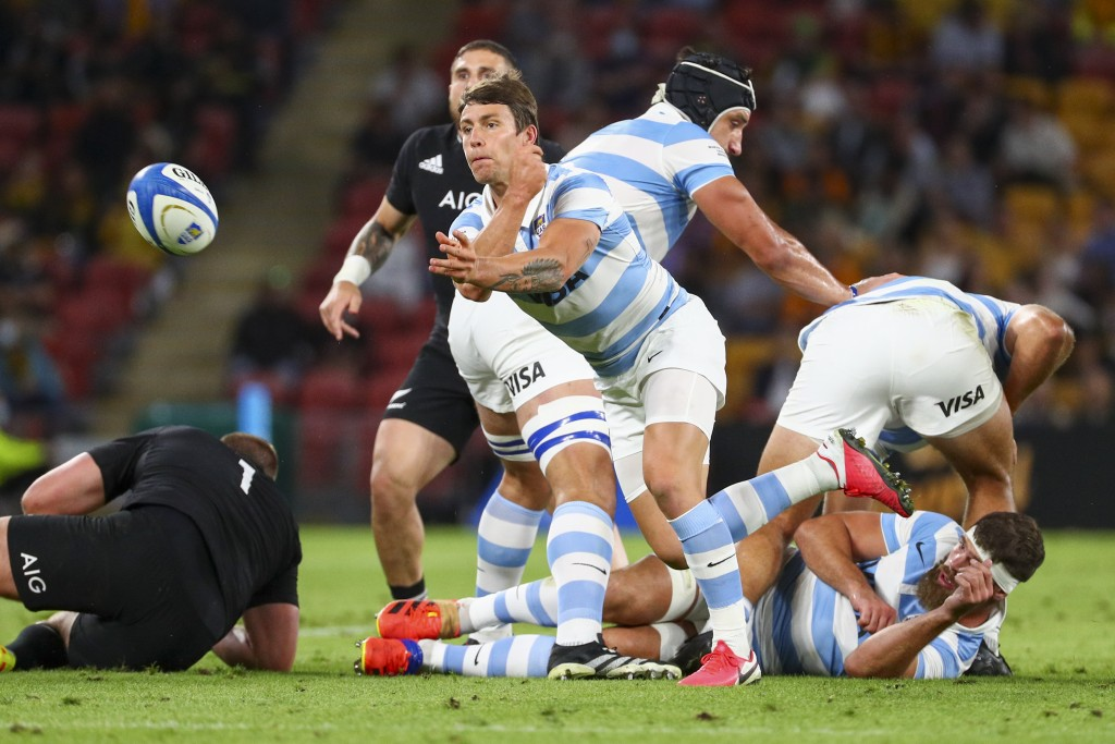 Argentina's Gonzalo Bertranou passes the ball clear of a ruck during the Rugby Championship test match between the All Blacks and the Pumas in Brisban...