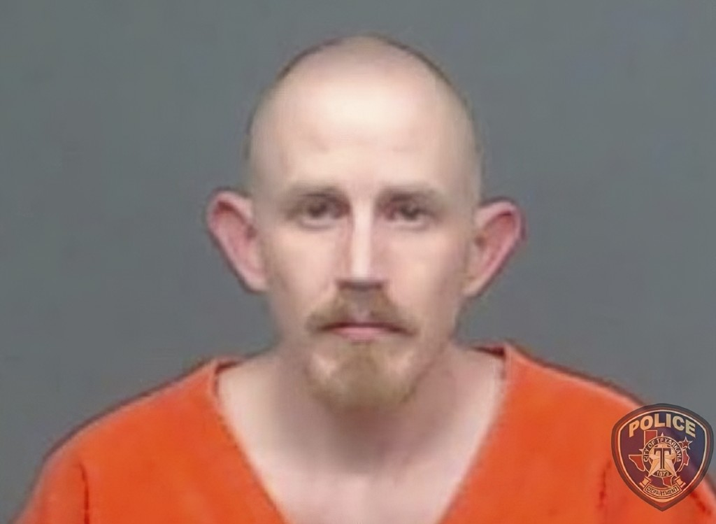 FILE - In this file image provided by the Texarkana, Texas, Police Department, Aaron Swenson is seen in his police booking photo. Swenson, linked to t...