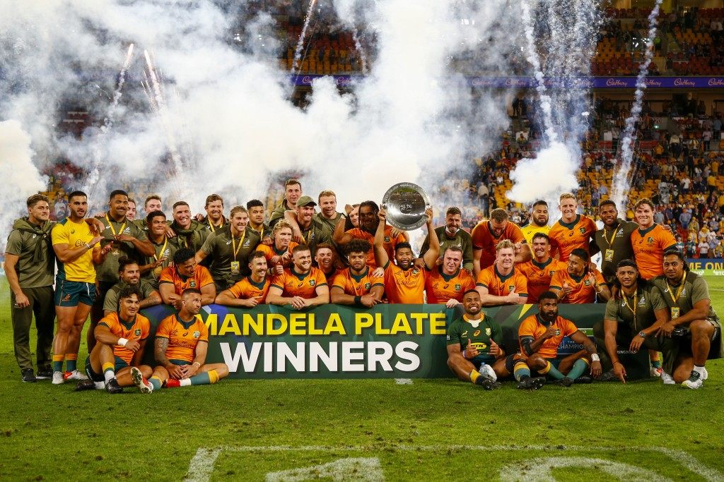 The Australian team celebrate after defeating South Africa to win the Nelson Mandela Plate during the Rugby Championship test match between the Spring...