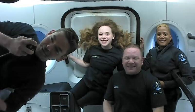This photo provided by SpaceX shows the passengers of Inspiration4 in the Dragon capsule on their first day in space. They are, from left, Jared Isaac...