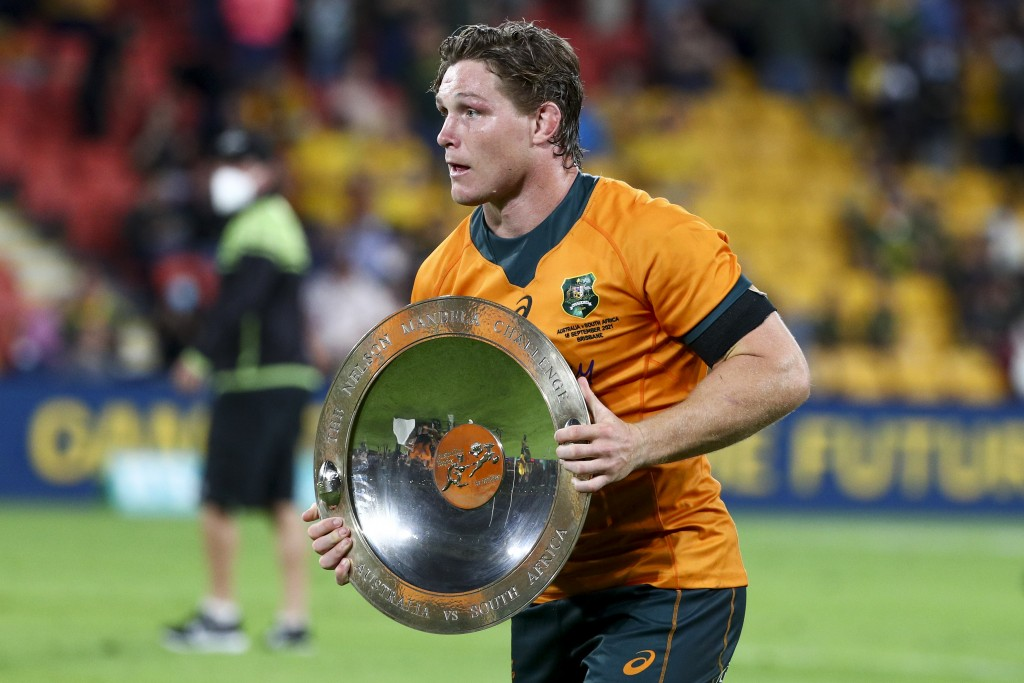 Australia's Michael Hooper holds the Nelson Mandela Plate after defeating South Africa in the Rugby Championship test match between the Springboks and...
