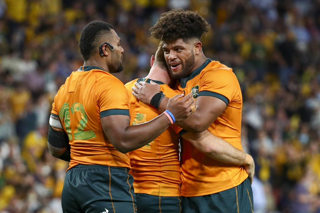 Australia's Samu Kerevi, left, Rob Valetini, right, and Andrew Kellaway celebrate after defeating South Africa in their Rugby Championship test match ...