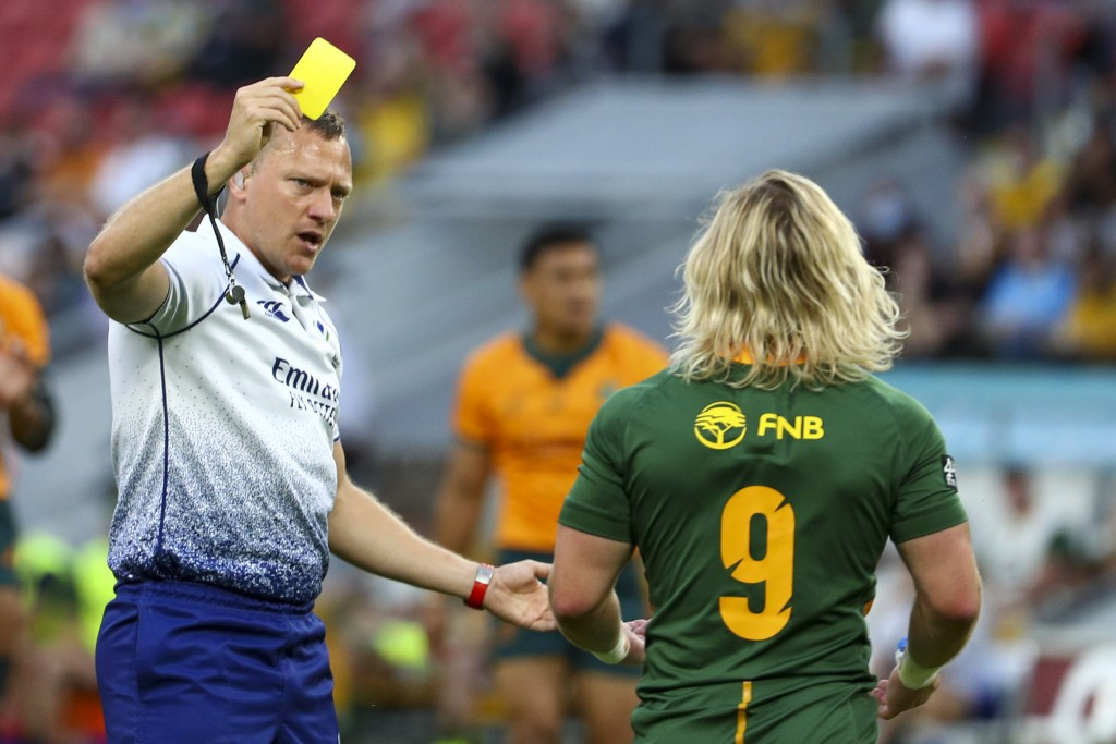 Referee Matthew Carley shows a yellow card to South Africa's Faf de Klerk during the Rugby Championship test match between the Springboks and the Wall...