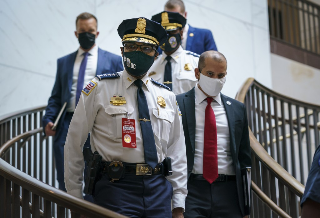 Washington Metropolitan Police Chief Robert Contee arrives to joined U.S. Capitol Police Chief Tom Manger at a news conference to discuss preparations...