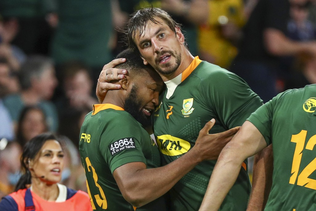 South Africa's Lukhanyo Am, left, is congratulated by teammate Eben Etzebeth after scoring a try during the Rugby Championship test match between the ...