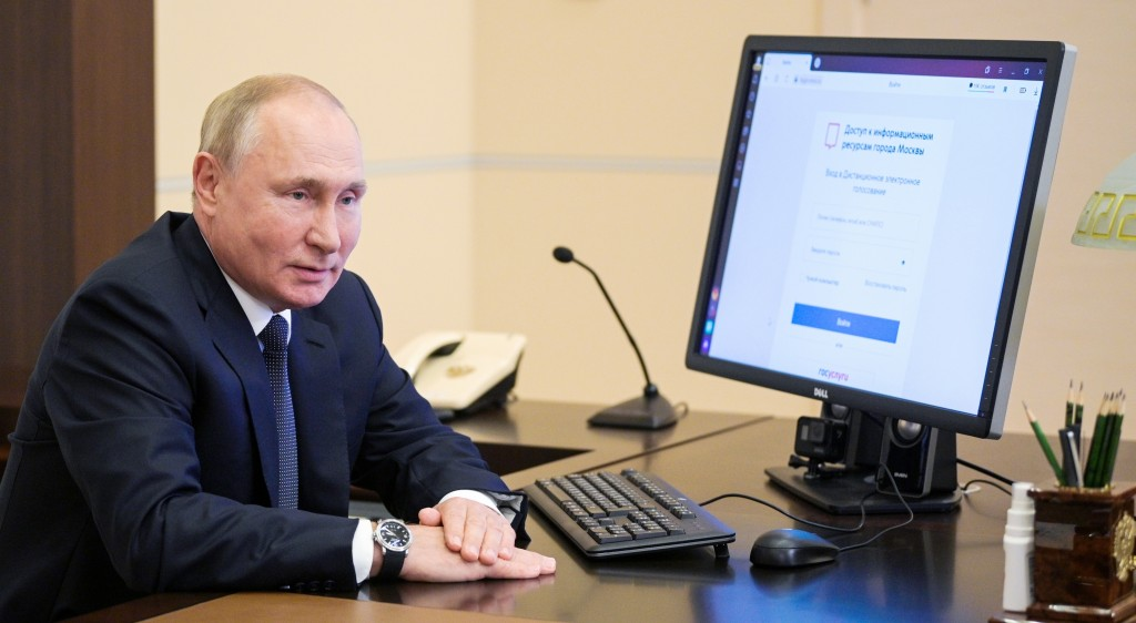 Russian President Vladimir Putin attends a remote electronic voting during Parliamentary elections at the Novo-Ogaryovo residence outside Moscow, Russ...