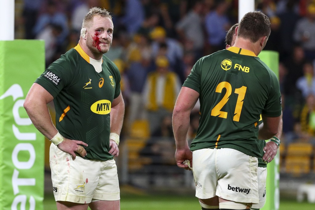 South Africa's Steven Kitshoff, left, reacts following his team's loss to Australia in their Rugby Championship test match in Brisbane, Australia, Sat...