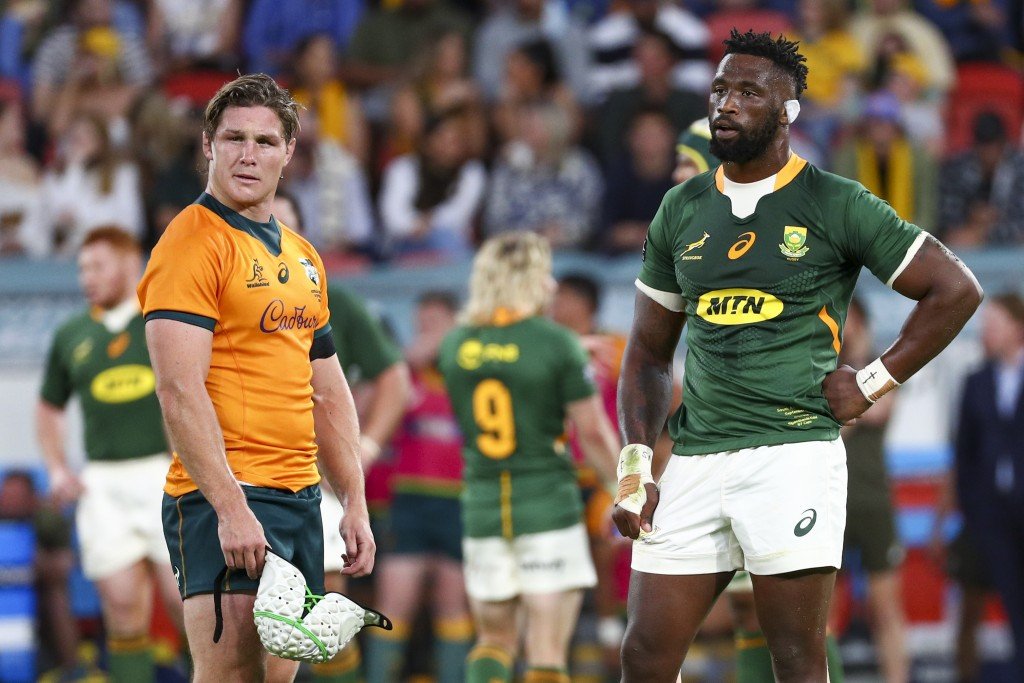 Rival captains Australia's Michael Hooper, left, and South Africa's Siya Kolisi react during the Rugby Championship test match between the Springboks ...