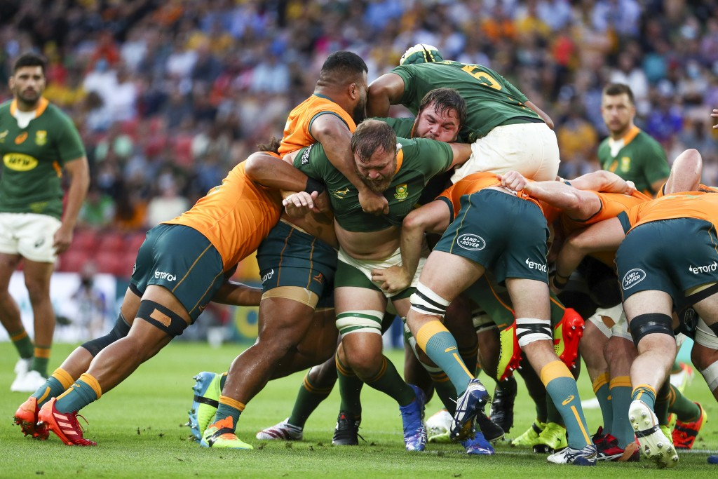 South Africa's Duane Vermeulen, centre, leads his forwards during the Rugby Championship test match between the Springboks and the Wallabies in Brisba...