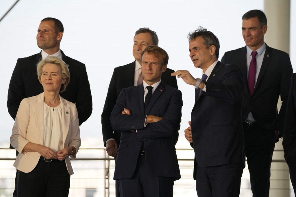 Greek Prime Minister Kyriakos Mitsotakis, right, shows the view of the Greek capital to French President Emmanuel Macron, center, European Commission ...