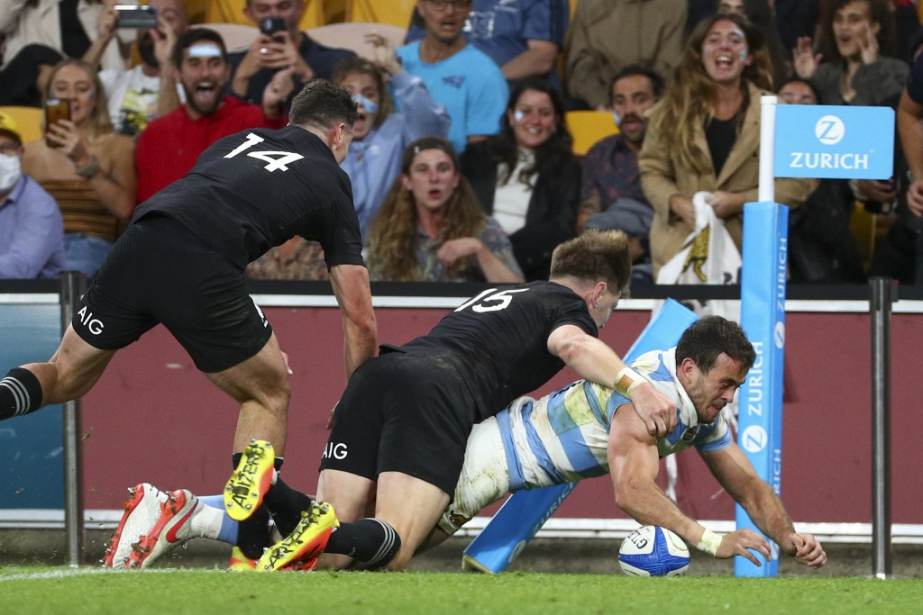 Argentina's Emiliano Boffelli scores a try during the Rugby Championship test match between the All Blacks and the Pumas in Brisbane, Australia, Satur...