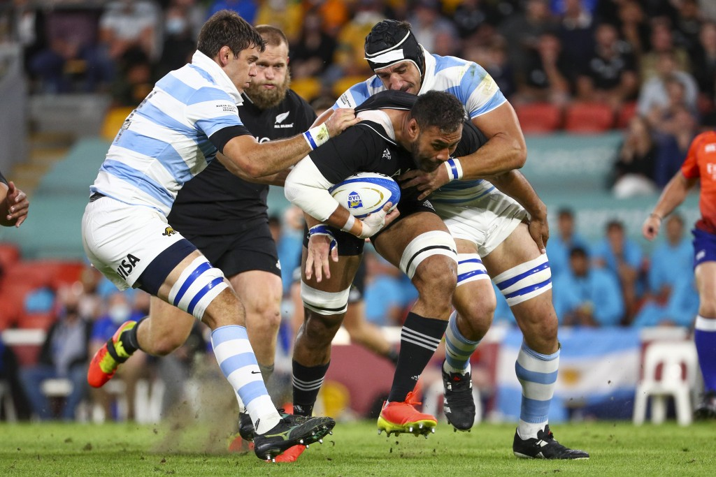 New Zealand's Patrick Tuipulotu is tackled by defenders during the Rugby Championship test match between the All Blacks and the Pumas in Brisbane, Aus...