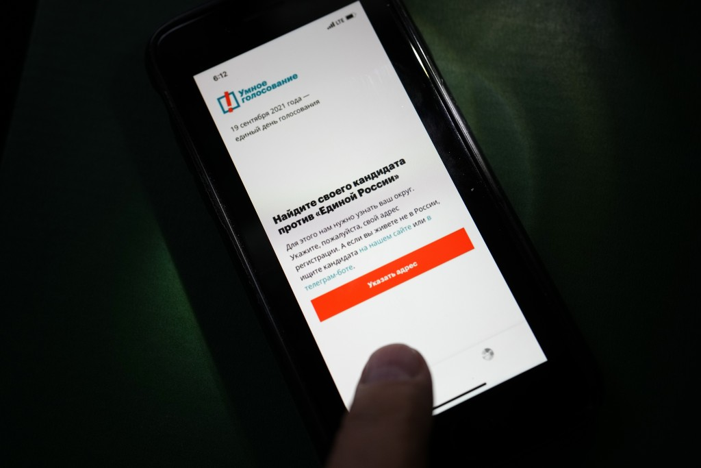 The app Smart Voting is displayed on an iPhone screen in Moscow, Russia, Friday, Sept. 17, 2021. Facing Kremlin pressure, Apple and Google on Friday r...