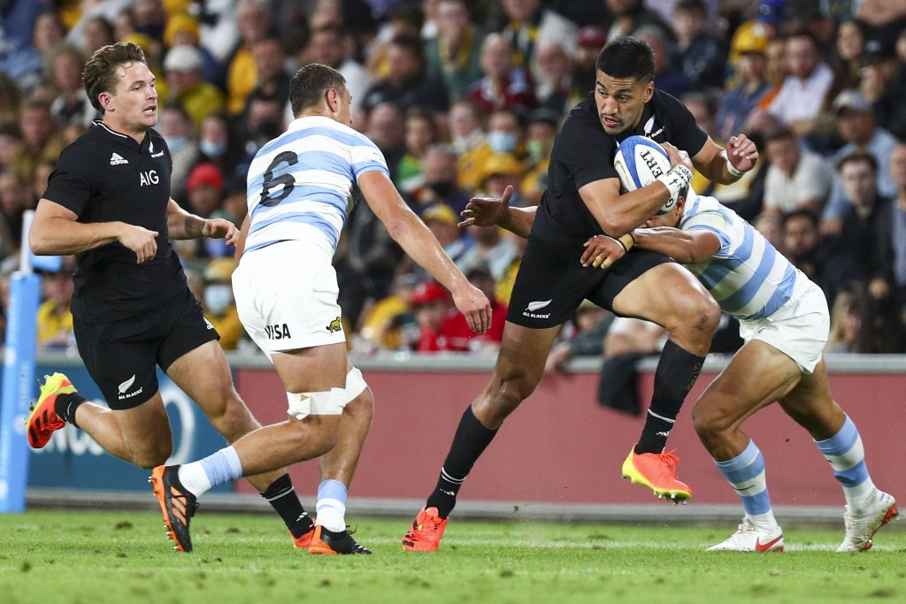 New Zealand's Rieko Ioane runs at the defense during the Rugby Championship test match between the All Blacks and the Pumas in Brisbane, Australia, Sa...
