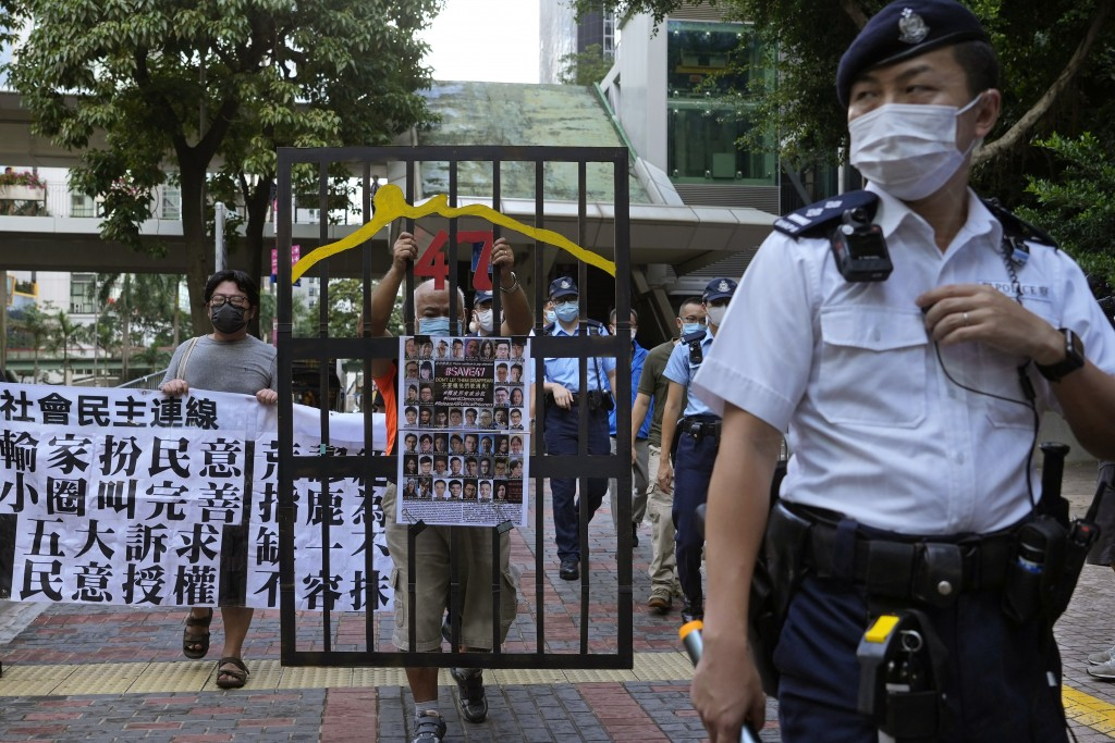A police officer guard at a street during a protest against an election committee that will vote for the city's leader in Hong Kong Sunday, Sept. 19, ...