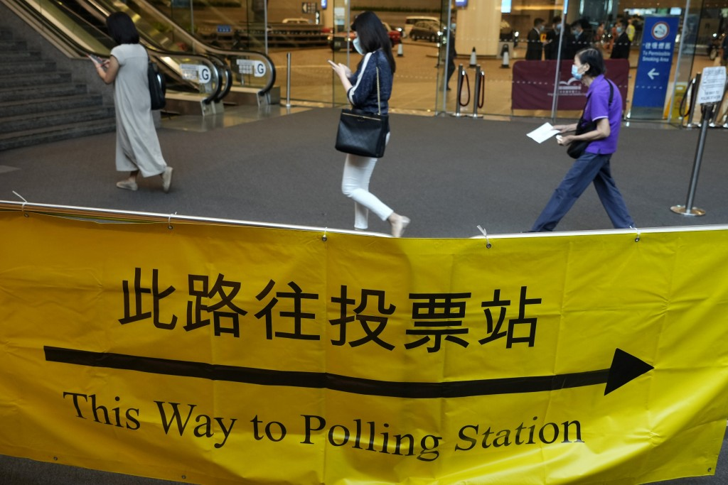 Voters enter a polling center for the election committee that will vote for the city's leader in Hong Kong Sunday, Sept. 19, 2021. Hong Kong's polls f...