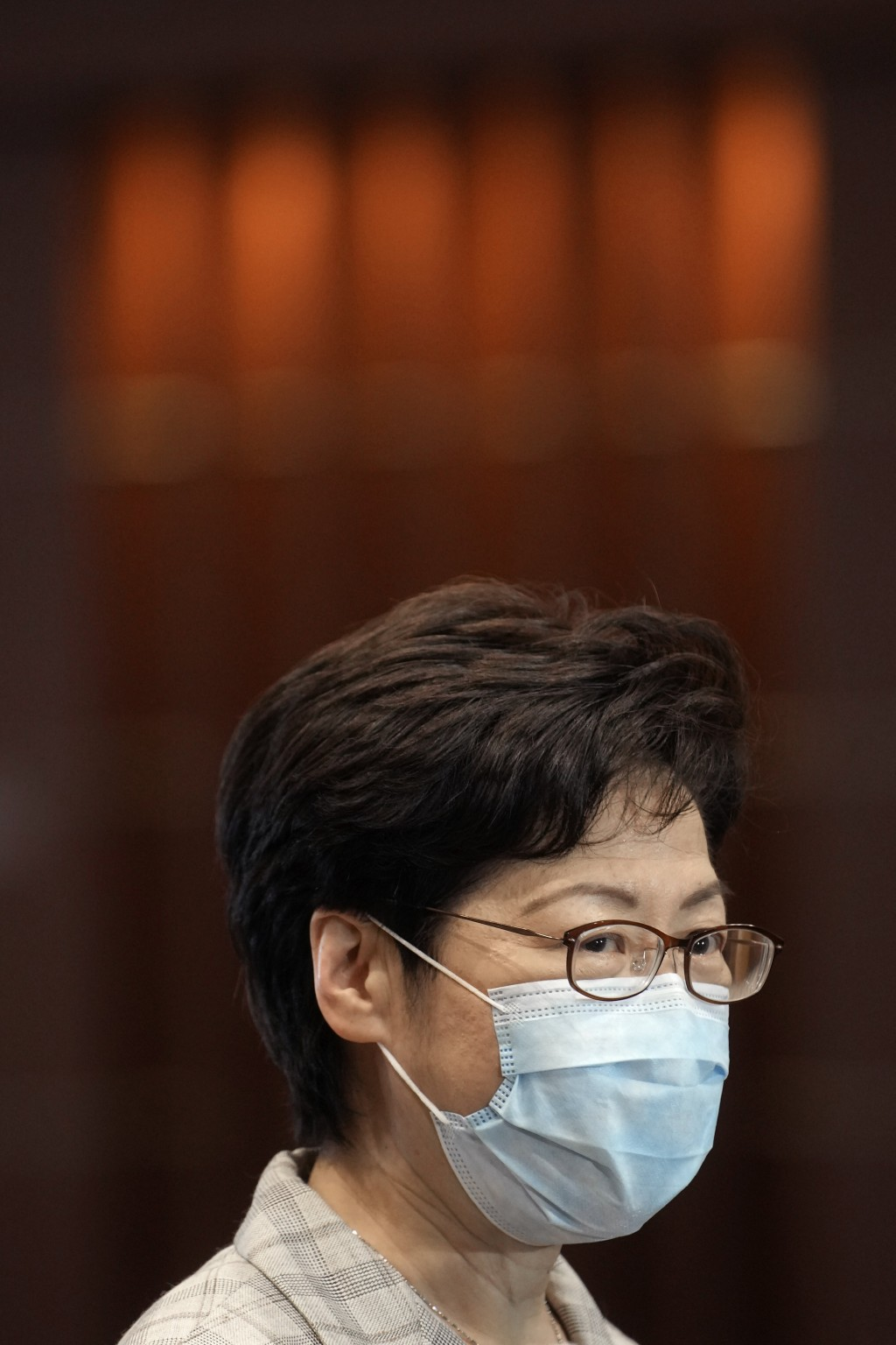 Hong Kong Chief Executive Carrie Lam speaks during a press conference at a polling center for the election committee that will vote for the city's lea...