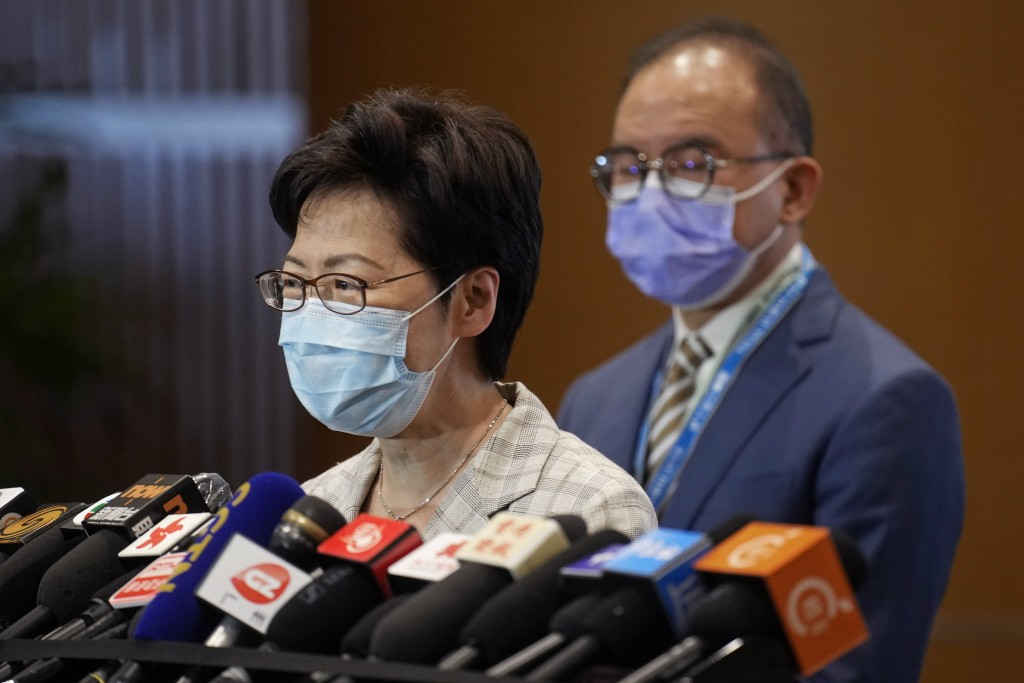 Hong Kong Chief Executive Carrie Lam, left, speaks, with Erick Tsang, Secretary for Constitutional and Mainland Affairs Bureau, behind her, during a p...