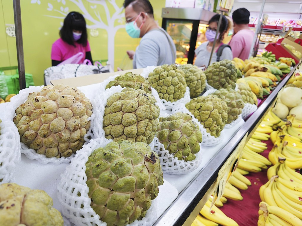 Taiwanese sugar apples for sale are displayed at a fruit stall in Taipei, Taiwan, Monday, Sept. 20, 2021.