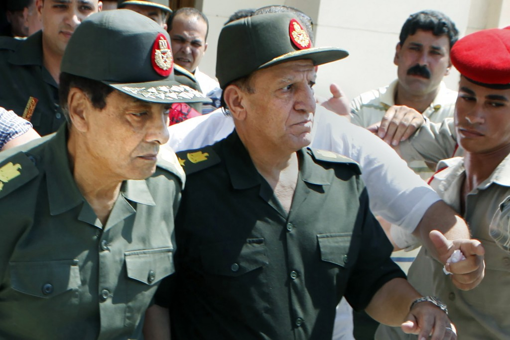FILE - In this Sept. 16, 2011, file photo, Egypt's then military ruler field marshal Hussein Tantawi, left, and Sami Annan, then Egyptian chief of sta...