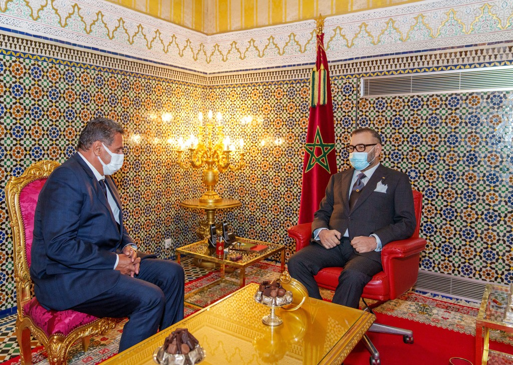 In this photo released by the Royal Palace, Morocco's King Mohammed VI, right, receives Aziz Akhannouch the president of the National Rally of Indepen...