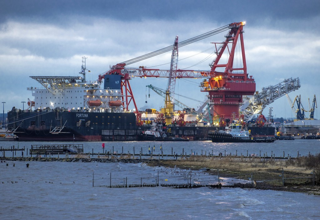 """FILE - In this Jan. 14, 2021 file photo, tugboats get into position on the Russian pipe-laying vessel """"Fortuna"""" in the port of Wismar, Germany. Almost..."""