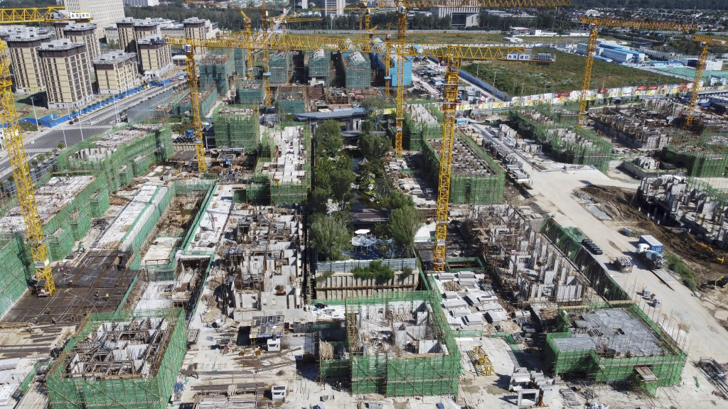 An aerial view of an Evergrande new housing development project is under construction in Beijing, Wednesday, Sept. 22, 2021. (AP Photo)