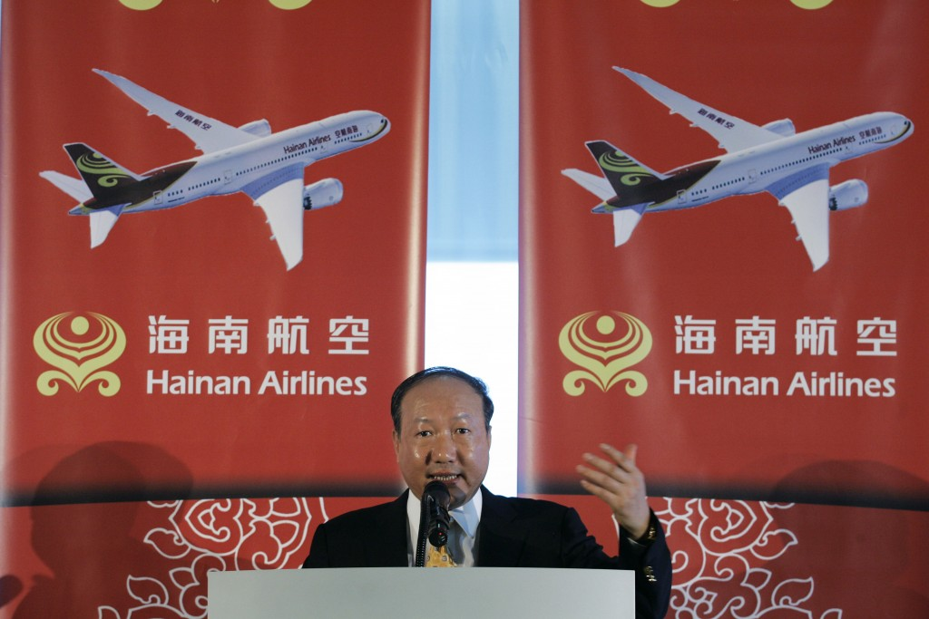 FILE - In this Monday, June 9, 2008 file photo, Chen Feng, chairman of HNA Group, the parent company of Hainan Airlines in China, gives a speech on th...
