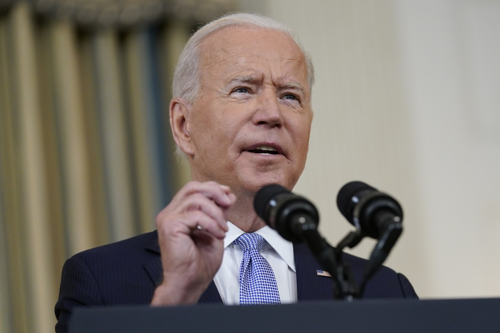 FILE - In this Sept. 24, 2021, file photo President Joe Biden speaks about the COVID-19 response and vaccinations in the State Dining Room of the Whit...