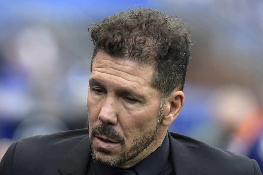 Atletico Madrid's head coach Diego Simeone walks to the bench before the start of a Spanish La Liga soccer match between Alaves and Atletico Madrid at...