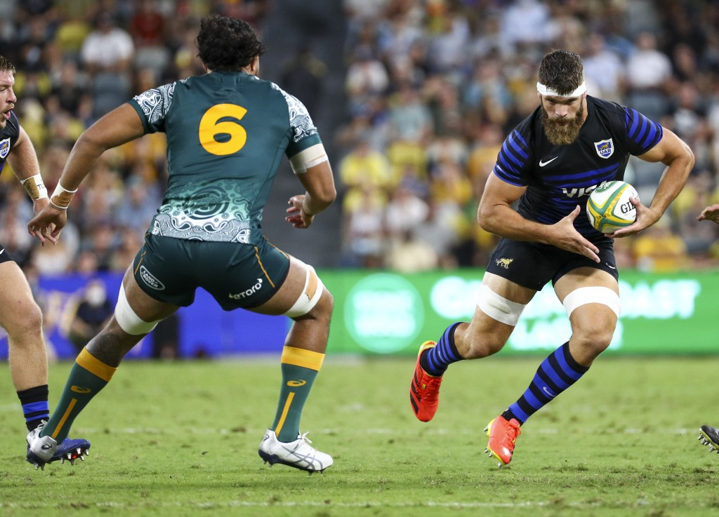 Argentina's Marcos Kremer, right, runs at Australia's Rob Leota during the Rugby Championship test match between the Pumas and the Wallabies in Townsv...