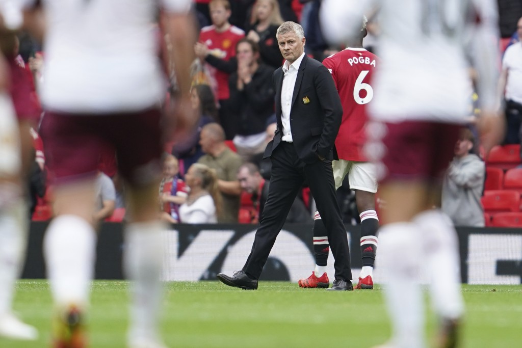 Manchester United's manager Ole Gunnar Solskjaer reacts at the end of the English Premier League soccer match between Manchester United and Aston Vill...