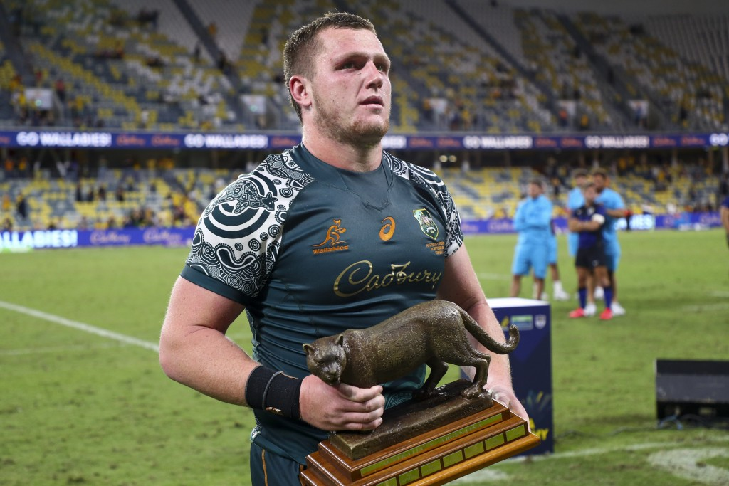 Australia's Angus Bell carries the trophy following the Rugby Championship test match between the Pumas and the Wallabies in Townsville, Australia, Sa...