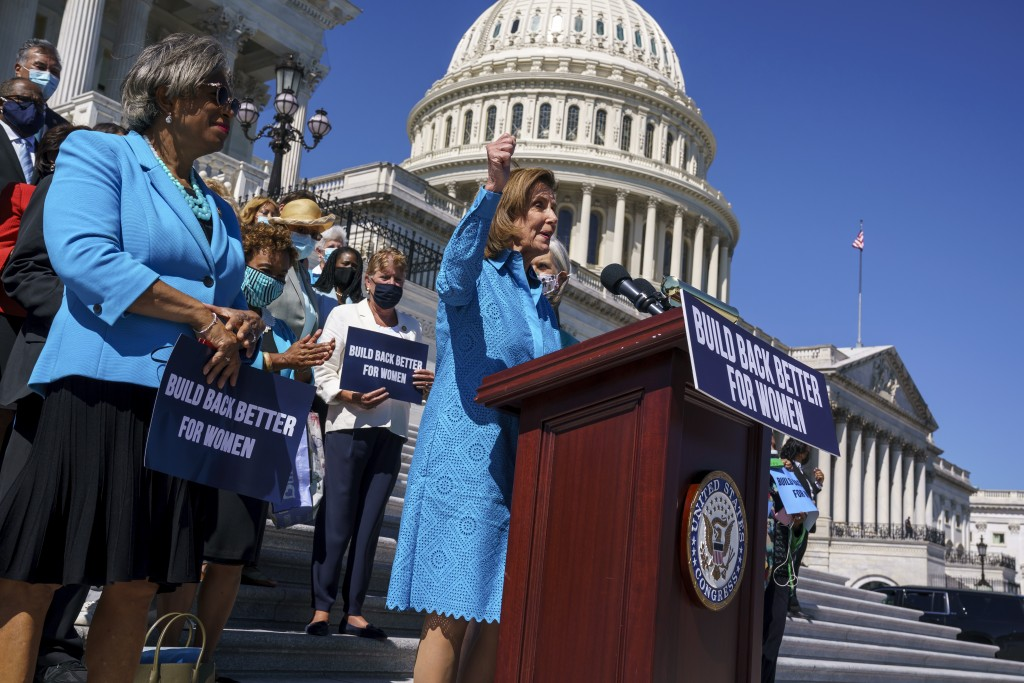 FILE - In this Sept. 24, 2021, file photo House Speaker Nancy Pelosi, D-Calif., joined at left by Rep. Brenda Lawrence, D-Mich., holds a rally in supp...