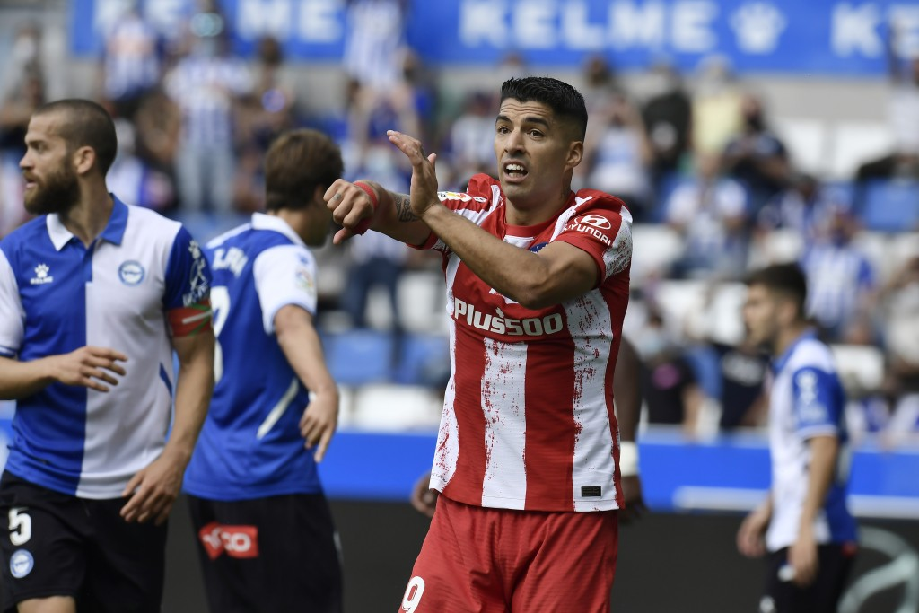 Atletico Madrid's Luis Suarez protests during a Spanish La Liga soccer match between Alaves and Atletico Madrid at the Mendizorroza stadium in Vitoria...