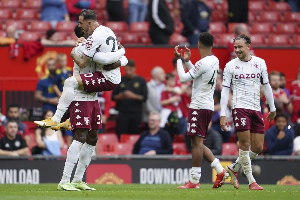Aston Villa players celebrate at the end of the English Premier League soccer match between Manchester United and Aston Villa at the Old Trafford stad...