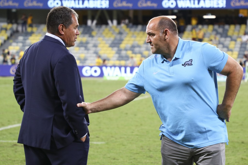 Australia's rugby coach Dave Rennie, left, talks with Argentina's coach Mario Ledesma following the Rugby Championship test match between the Pumas an...