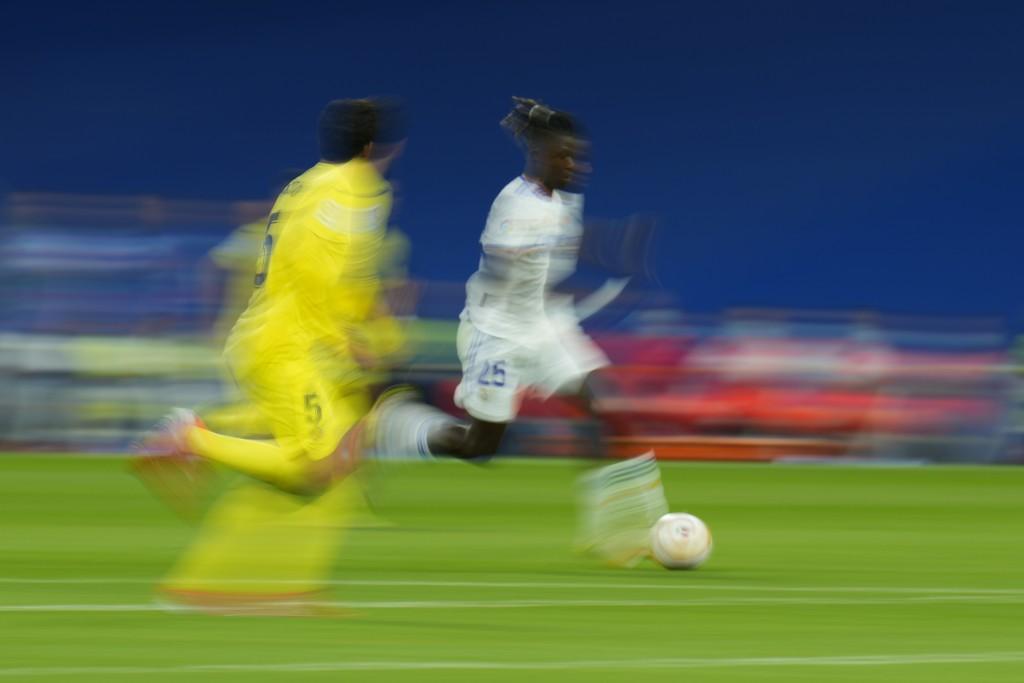 Real Madrid Camavinga runs with the ball as Villarreal's Dani Parejo defends during a Spanish La Liga soccer match between Real Madrid and Villarreal ...