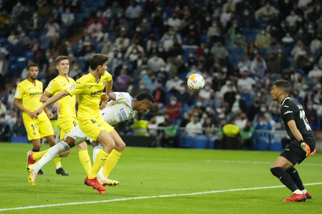 Real Madrid's Eder Militao, dives, but puts his header wide of the goal during a Spanish La Liga soccer match between Real Madrid and Villarreal at th...