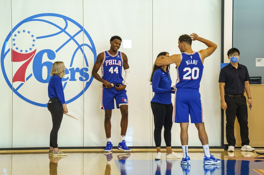 Philadelphia 76ers forward Paul Reed, (44) and Georges Niang, right, talk things over as they move from section to section during the NBA basketball t...