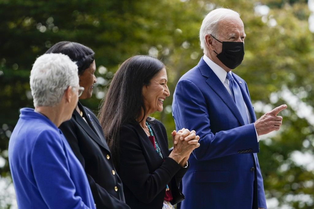 President Joe Biden gestures on the North Lawn of the White House in Washington, Friday, Oct. 8, 2021, with White House national climate adviser Gina ...