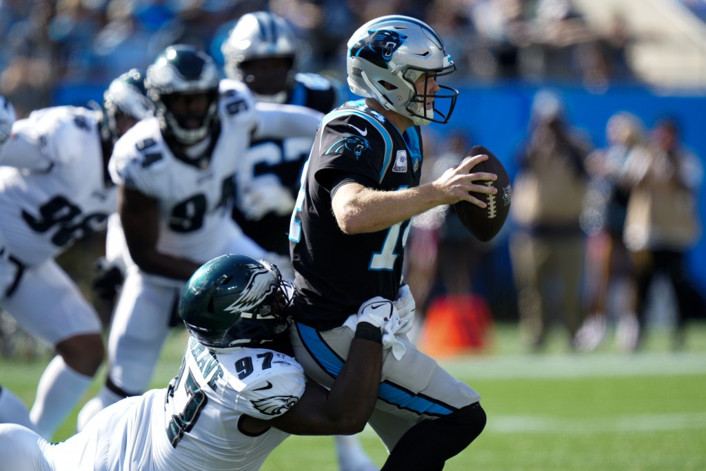 Carolina Panthers quarterback Sam Darnold is sacked by Philadelphia Eagles defensive tackle Javon Hargrave during the second half of an NFL football g...