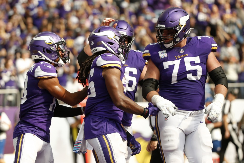 Minnesota Vikings running back Alexander Mattison, center, celebrates with teammates after catching a 15-yard touchdown pass during the first half of ...