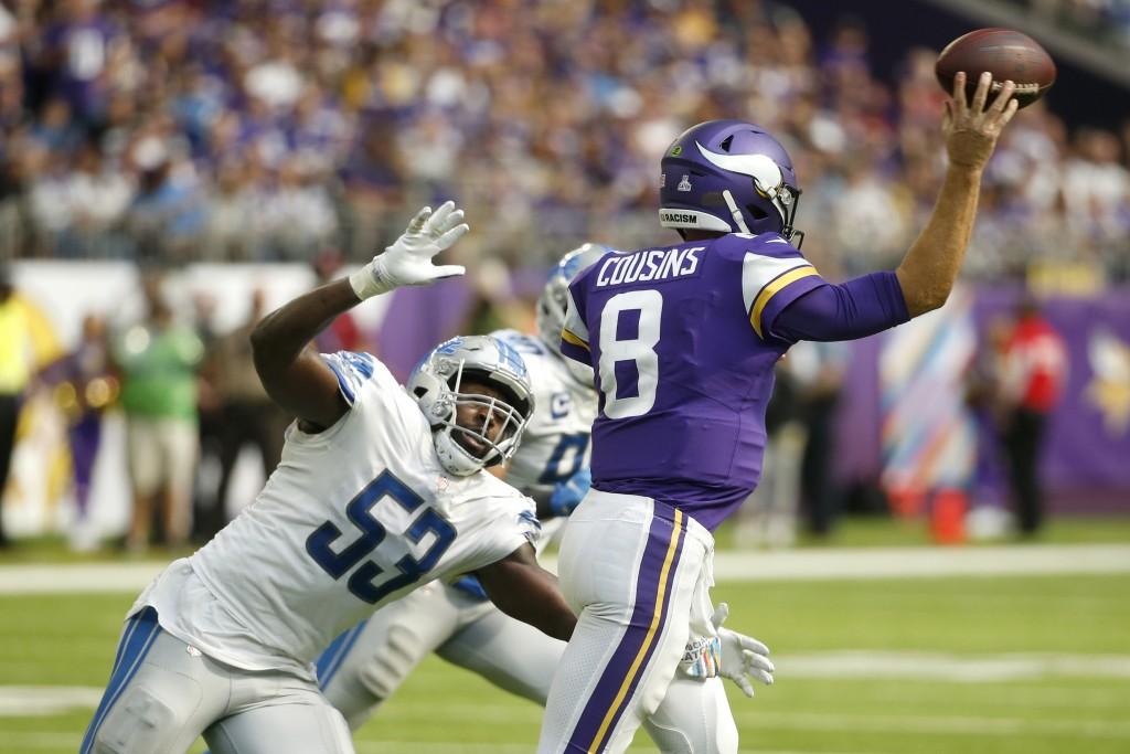 Detroit Lions outside linebacker Charles Harris (53) pressures Minnesota Vikings quarterback Kirk Cousins (8) during the second half of an NFL footbal...