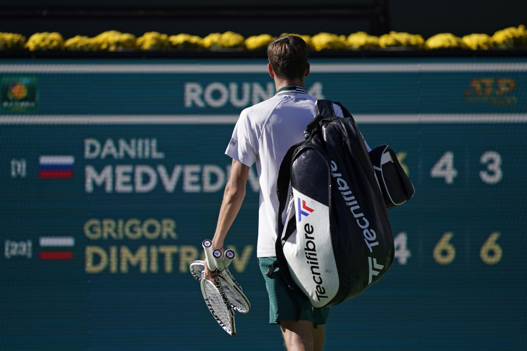 Daniil Medvedev, of Russia, walks off the court after losing to Grigor Dimitrov, of Bulgaria, at the BNP Paribas Open tennis tournament Wednesday, Oct...