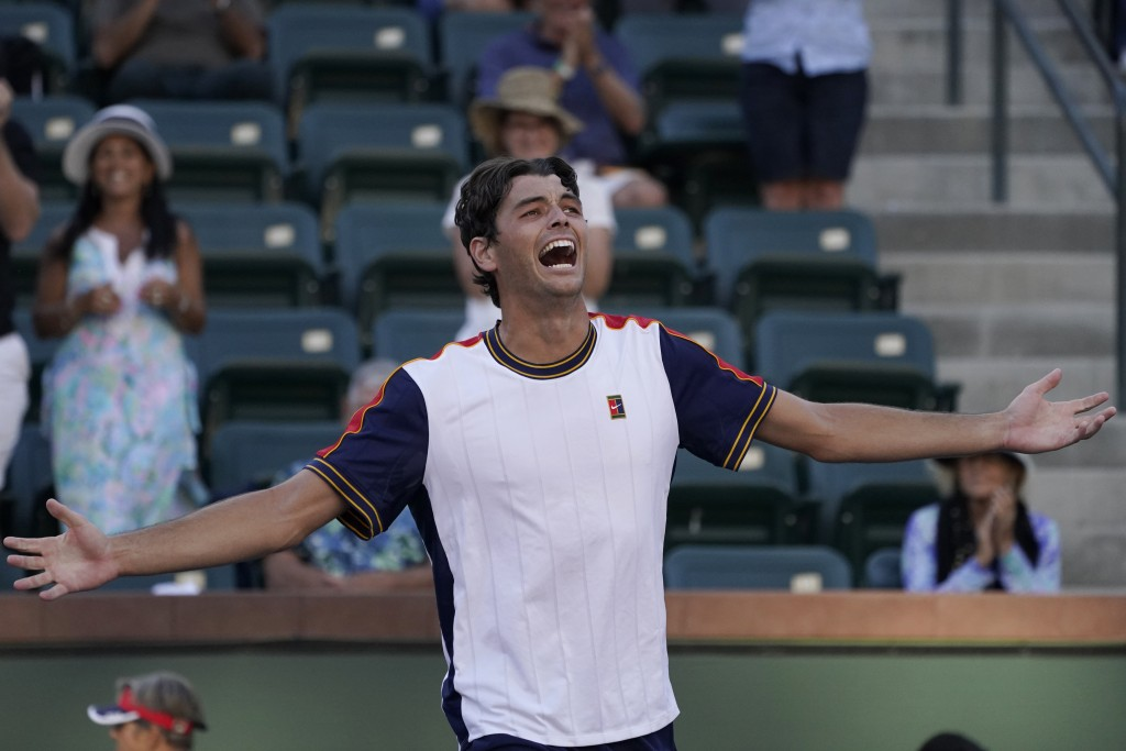 Taylor Fritz celebrates after defeating Jannik Sinner, of Italy, at the BNP Paribas Open tennis tournament Wednesday, Oct. 13, 2021, in Indian Wells, ...